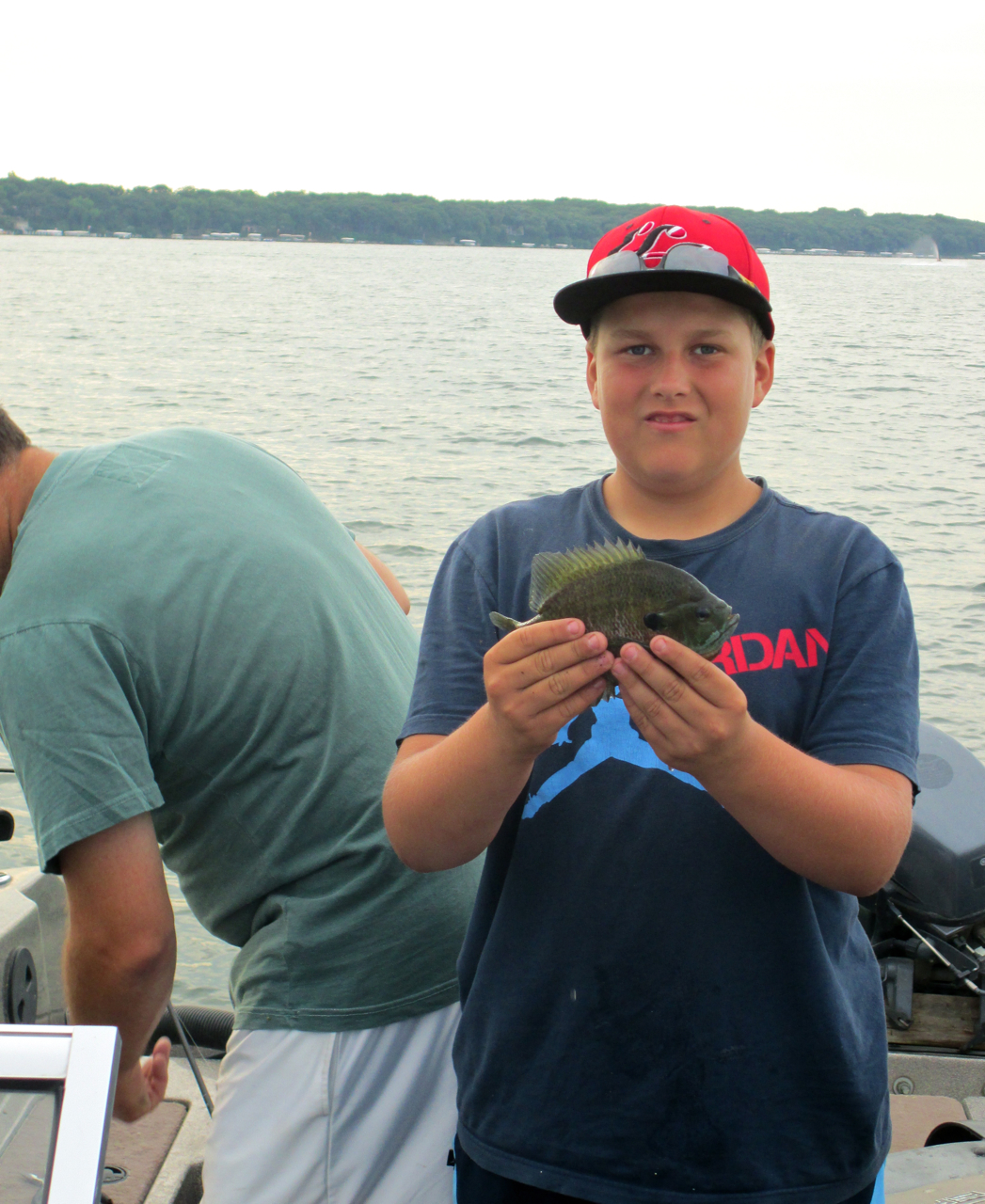 (photo by Steve Weisman) The author's grandson, Hunter with a nice bluegill taken on a Shuck's Jigger Minnow.
