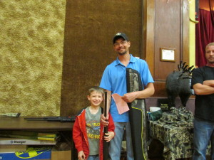"""Pictured are Tanner & Lucas Dixon of Anthon IA.  Tanner won this H&R Pardner Pump shotgun in the special youth drawing.  Tanner said, """"I can't wait to get home and try it out!"""""""