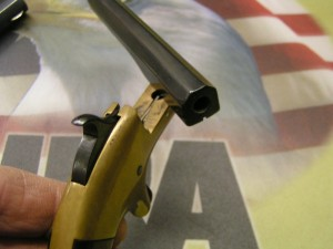 """This particular derringer is known as a """"single-shot side pivot derringer""""."""