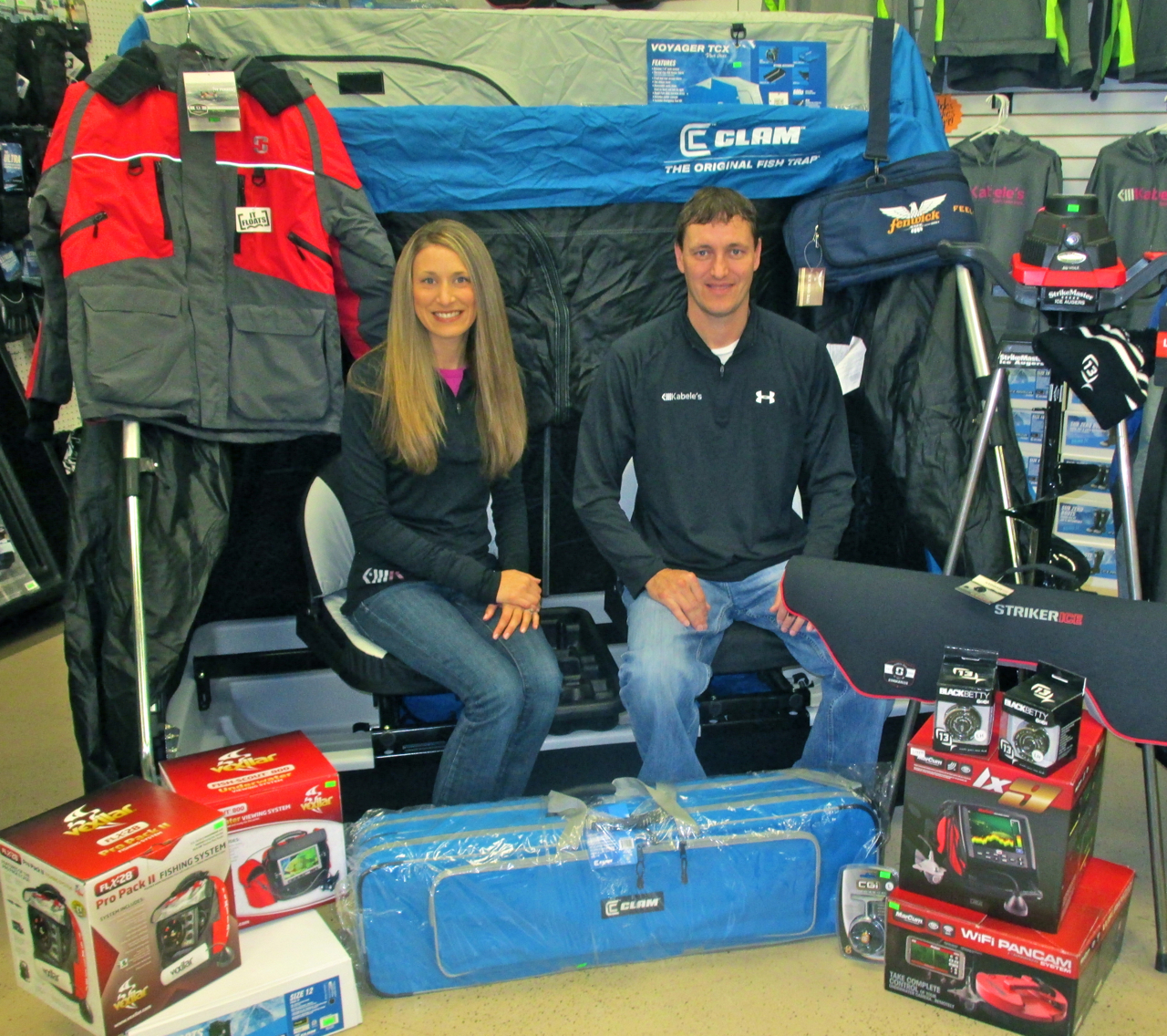 "(photo by Steve Weisman) Ice fishing gear is taking over at Kabele's Trading Post. Owners Tanya and Thane Johnson sit in the middle of just a sampling of the ice fishing products people will see at the third annual ""Shop with the Pros"" day on Saturday, November 15."