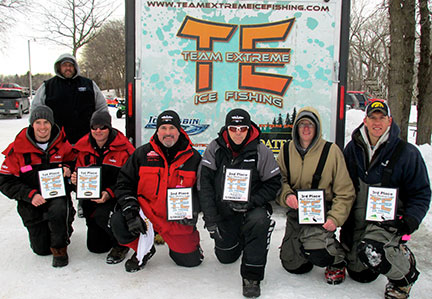 (photo by Steve Weisman) Top three placing teams at the Team Extreme tournament on West Okoboji. (L to R) Jon Furman and Jade Furman, 1st place; Scott Reed and John Grosvenor, 2nd place; Brett Sichmeller and Blain Fopma, 3rd place.