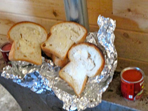 Fresh walleye wrapped in tin foil with slices of homemade, buttered bread and two cans of pork 'n beans, all prepared on the propane stove.