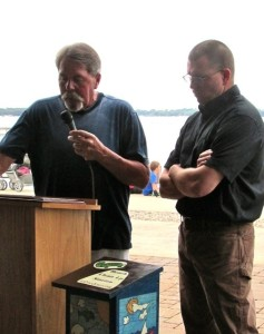 (Photo by Steve Weisman) Greg Drees (L) introduces Steve Anderson as the 2015 Ace Cory Conservation award winner at the Okoboji Protective Association's annual meeting held during the Clean Water Concert activities.