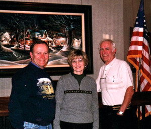 (photo by Julie Ranum): The author, his wife Darial and Terry Redlin pose for a picture during a 2004 interview.