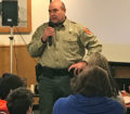 (photo by Steve Weisman) Greg Harson, Law Enforcement Supervisor for conservation officers in District 1, visits with members of the IGLFC at the annual fall meeting.