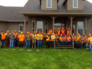 Guides and those who participated in the Ladies Pheasant Hunt take a break after the day's activities.