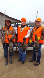 (L to R) Success! Julie Beehler, Kristi Franker, Kaylee Iedema with the roosters that they bagged.