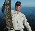 (photo by Bob Jensen) Craig Brown from McArdle's Resort on Lake Winnibigoshish in northern Minnesota caught this nice pike in the autumn.